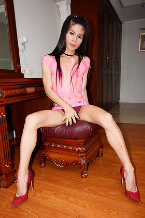 Petite all-natural Deni sits on a stool with her slim legs open and stroking the cock underneath her panties.