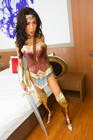 Sexy Mos is dressed for sexual battle as Wonder Woman, carrying her sword and shield.