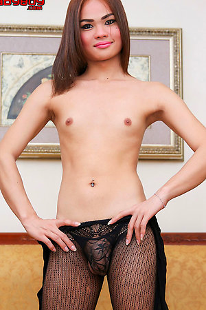 Big cock ladyboy Ning is a sexy fresh faced girl with a hot body and cute budding tits.