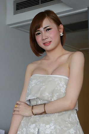 20 year old Thai ladyboy gets naked and fucks tourist