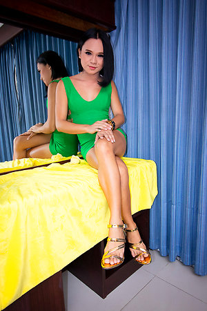 Ladyboy Bon soft body is wrapped up in tight green dress.