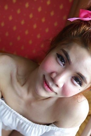 Petite and very feminine Ladyboy lavishes in the luxury of white travelers cock